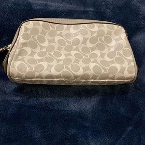 Gray small Coach makeup bag